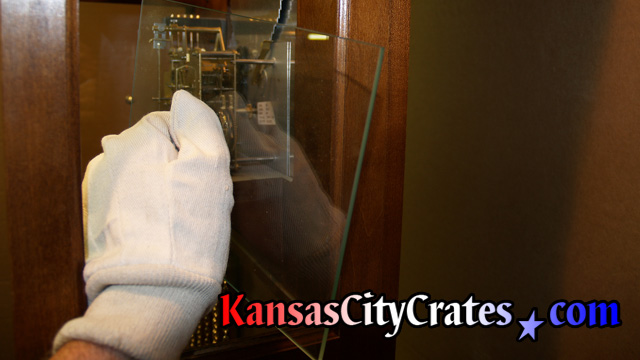Example photo of handling different items with white gloves, or Kid gloves, so fingerprints and smudges are not left on its surface.