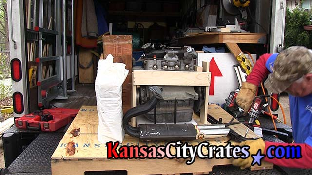 Crate builder assembles frame around motor on pallet