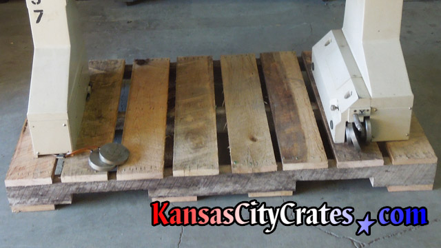 Upper portion of machinery on rough oak ISO pallet.