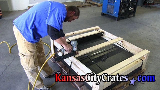 On-site crating for machinery loaded onto custom built pallet.