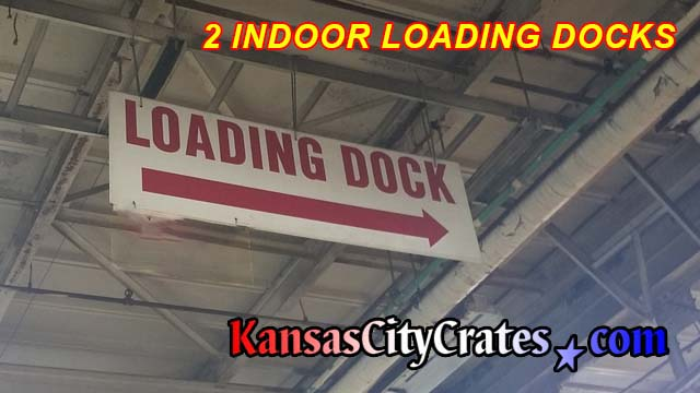 Sign directing drivers to indoor loading dock