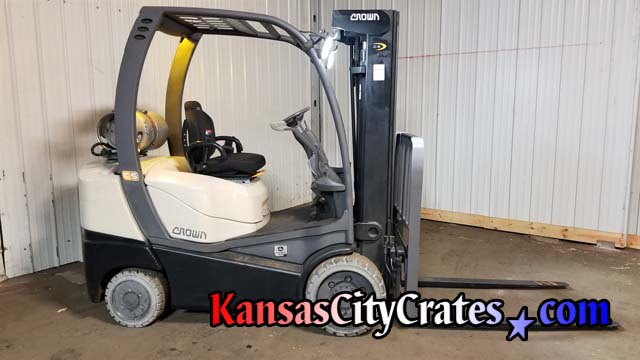 2013 Crown C5 Internal Combustion cushion model forklift powered by John Deere to load crates and unload materials