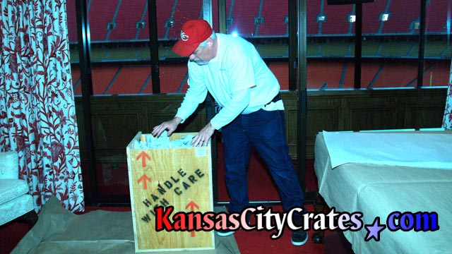 Packing indestructible box crate for private collector at football stadium