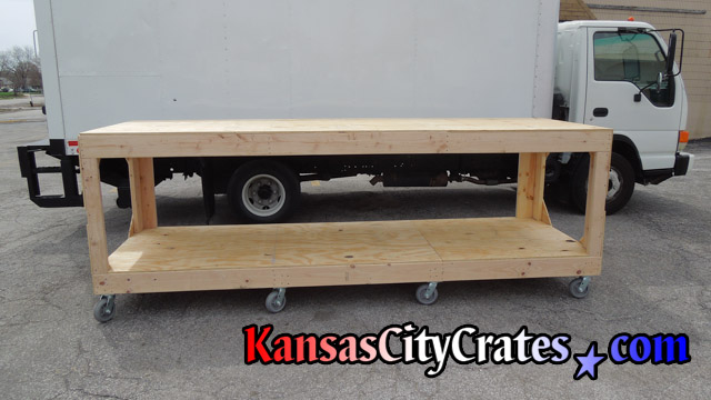 Custom built wood cart to transport materials in an orderly fashion.